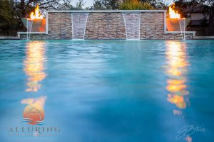 geometric pool with fire and fountain feature